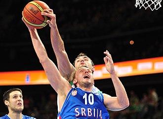 Block (basketball) - Mirza Begić blocks Duško Savanović at the EuroBasket 2011