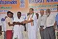 Shri M. Krishanassamy, Member of Parliament distributing prizes to participants of the Bharat Nirman Public Information Campaign, at Gingee, Tamil Nadu. The Director, PIB, Chennai, Shri M.V.S. Prasad and the Dy. Director.jpg