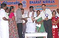 Shri P. Viswanathan, MP, handing over the sanction orders of students education loan being extended by lead bank, at the inauguration of the Bharat Nirman Public Information Campaign at Maduranthakam.jpg