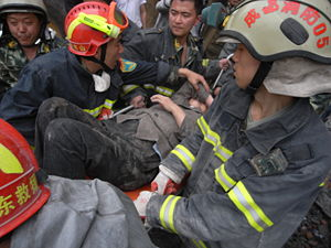 Urban search and rescue - Rescuers with a victim of the 2008 Sichuan earthquake.