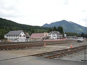 Skykomish, Washington - The heart of Skykomish (2008). In foreground, the BNSF tracks. Behind that, left to right: Skykomish Historical Society Museum, Maloney's General Store, listed on the National Register of Historic Places, Skykomish Hotel, Cascadian Hotel and Café.