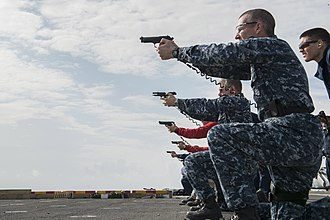 Marksmanship Ribbon - Small-arms Qualification Course exam aboard USS America
