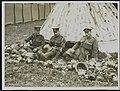 Sorting out helmets and gasmasks from German prisoners, Bestanddeelnr 158-0236.jpg