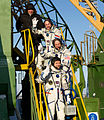 Soyuz TMA-03M crew members wave farewell.jpg