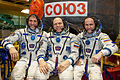 Soyuz TMA-10M crew in front of their spacecraft.jpg