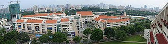 Saint Andrew's School, Singapore - A top view of St Andrew's Secondary School (left) and St Andrew's Junior School (right). The multi-coloured grandstand of the running track of St Andrew's Junior College (top right) can be seen as well.