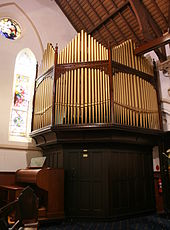A photograph of the pipe organ, including the console