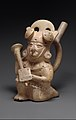 Stirrup spout bottle with warrior figure MET DT341205.jpg