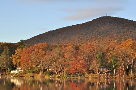 Stissing Mountain from across Stissing Pond; a firetower is visible at the summit Stissing Mountain and pond.JPG