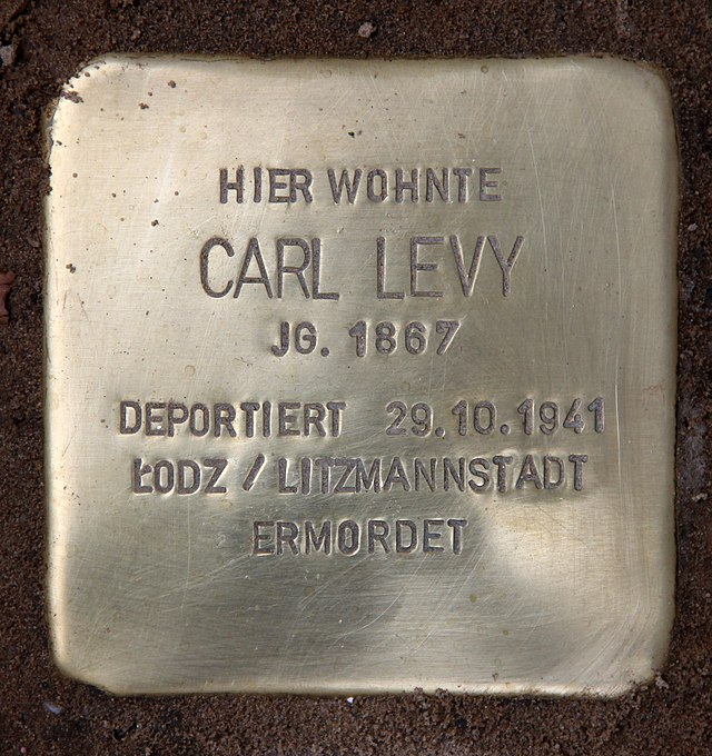 Photo of Carl Levy brass plaque