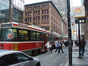 Queen station - A 501 Queen streetcar stops outside the station entrance