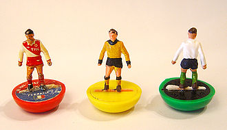 Subbuteo - Heavy weight players from the 1970s. The one on the left is a customised figurine representing an AS Monaco player. The other two are as originally painted by Ray Green himself, reference 6 in yellow and ref 65 in white representing the United Kingdom side that played against Wales in 1969