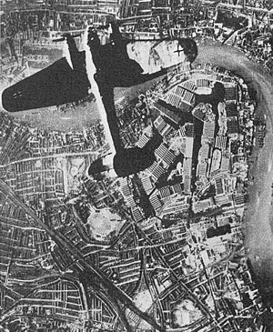 Surrey Commercial Docks - Heinkel He 111 German bomber over the Surrey Docks, Southwark, London (German propaganda photomontage).