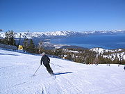 Man skiing slope overlooking Lake Tahoe