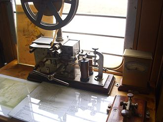 Electrical telegraph - A printing electrical telegraph receiver, with transmitter key at bottom right