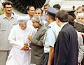 The President Dr. A.P.J. Abdul Kalam talking to the Prime Minister, Dr. Manmohan Singh before his departure to Tanzania, in New Delhi September 11, 2004.jpg