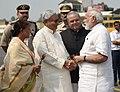 The Prime Minister, Shri Narendra Modi being welcomed by the Governor of Bihar, Shri Satya Pal Malik and the Chief Minister of Bihar, Shri Nitish Kumar, on his arrival, in Patna, Bihar on October 14, 2017 (2).jpg