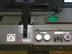 Automatic train operation - The two white ATO start buttons beside the power/brake lever in a Tokyo Metro 10000 series train, corresponding to GoA 2 operation