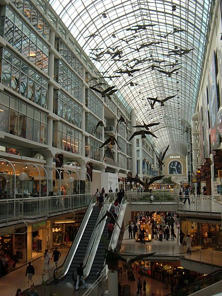 Interior of the Eaton Centre showing one of Michael Snow's best known sculptures Flightstop, which depict Canada geese in flight. TorontoEatonCentre.jpg
