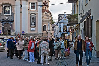 Tourists in the Old Town of Vilnius Tourism has certainly reached Vilnius - Old Town, Sept. 2008 (2937998142).jpg