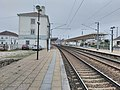 Tracks and and left side view of Albergaria dos Doze train station.jpg