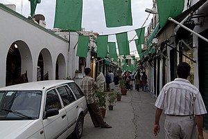 The Libyan flag decorates a street in the Trip...