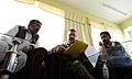 U.S. Army Lt. Col. Anthony Ulrich, center, the Farah Provincial Reconstruction Team (PRT) civil affairs commander, discusses security with Abdul Ghafaar, left, the Farah chief prosecutor, in Farah city, Farah 120829-N-II659-1233.jpg
