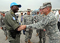 U.S. Army Lt. Gen. Ken Keen, Joint Task Force-Haiti, greets one of the United Nations (UN) peacekeepers working in and around Ancien Aeroport Militaire, a camp for internally displaced persons in Port-au-Prince 100306-N-HX866-009.jpg