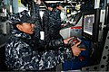 U.S. Navy Gunner's Mate 3rd Class Akilch Morris uses the remote operator console on the bridge to monitor surface contacts near the ship while transiting out of Pyeongtaek, South Korea, in the pilot house 130319-N-TG831-154.jpg