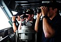 U.S. Navy midshipmen observe surface contacts through binoculars June 10, 2013, aboard the aircraft carrier USS George H.W. Bush (CVN 77) in the Atlantic Ocean 130610-N-XE109-041.jpg