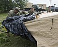 U.S. Sailors with Mobile Diving and Salvage Unit 2 erect a shelter system to serve as the unit's headquarters for diving operations during Ardent Sentry 2013 at Marine Corps Recruit Depot Parris Island, S.C 130513-N-IL267-007.jpg