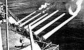 USS Salem (CA-139) fires main artillery in 1952.jpg