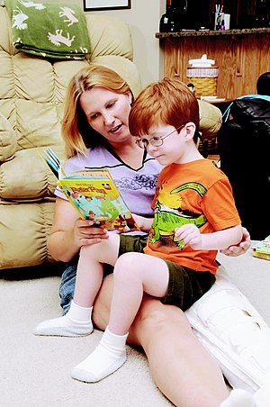 Kelli Reynoldson and her son, Alex, 5, read to...