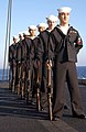 US Navy 030108-N-4953E-004 Members of the Harry S. Truman ceremonial saluting detail stand at parade rest during a Burial-At-Sea ceremony.jpg