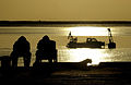 US Navy 030328-N-3783H-152 Members of Commander Task Unit (CTU-55.4.3) watch the sunrise at the port of Umm Qasr, Iraq.jpg