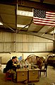 US Navy 030328-N-3783H-345 Members of Commander Task Unit (CTU-55.4.3) eat breakfast in the warehouse they've occupied at the port of Umm Qasr, Iraq.jpg