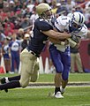 US Navy 031004-N-9693M-735 Air Force quarterback Chance Harridge is sacked by Navy's safety Josh Smith.jpg