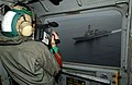 US Navy 031109-N-4768W-145 Photographer's Mate 3rd Class Tina Lamb, from Delran N.J., videotapes the guided-missile destroyer USS Howard (DDG 83) from the window of a CH-46D Sea Knight assigned to the Gunbearers of Helicopter C.jpg