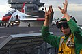US Navy 040302-N-4308O-116 A flight deck crewman signals that he is about to launch a T-45C Goshawk assigned to Training Air Wing One from the flight deck aboard USS Harry S. Truman (CVN 75).jpg