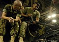 US Navy 040611-N-2972R-060 Marine Cpl. Anthony Borja, from Dededo, Guam, removes debris from an M-14 Assault Rifle with his field knife.jpg
