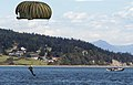 US Navy 040617-N-5134H-002 A U.S. Air Force Parachutist, assigned to the 66th Training Squadron, prepares to land in the water of Crescent Harbor.jpg