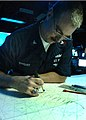 US Navy 040702-N-2613R-011 Operations Specialist 1st Class Robert G. Swigart, of Fountain Valley, Calif., plots the position of the amphibious assault ship USS Belleau Wood LHA 3.jpg