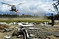 US Navy 050112-N-6074Y-258 An MH-60S Knighthawk helicopter prepares to land in a village in which little remains following the earthquake and Tsunami that affected the region.jpg