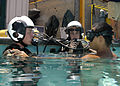 US Navy 050708-N-9500T-066 Two students prepare to submerge and breathe from SCUBA tanks as part of a familiarization course in the use of the Helicopter Emergency Escape Device at Aviation Survival Training Center.jpg