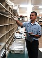 US Navy 050805-N-0168J-003 Ship's Serviceman 3rd Class Steve Lalangan sorts incoming mail inside the post office at Fleet Activities Sasebo.jpg