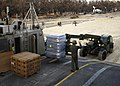 US Navy 050906-N-6925C-003 A crew member aboard a U.S. Navy Landing Craft, Air Cushion (LCAC), directs the unloading of bottled water on a beach near Biloxi, Miss.jpg