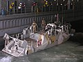 US Navy 051106-N-6708W-180 A Norwegian patrol craft prepares to moor in the well deck aboard the dock landing ship USS Gunston Hall (LSD 44).jpg