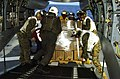 US Navy 060219-N-5067K-013 Humanitarian supplies are loaded aboard a CH-46E Sea Knight.jpg