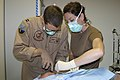 US Navy 060317-N-3207B-021 Lt. Dedrick Luikens, assigned to Patrol Squadron Four Seven (VP-47), and Maj. Amy Olsen, assigned to 379th Air Expeditionary Wing, perform surgery.jpg