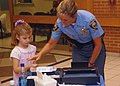 US Navy 060830-N-8907D-010 Officer Diane Branch with the Chesapeake Police Department takes children's fingerprints during the Ident-a-Kid program held at Naval Medical Center Portsmouth.jpg